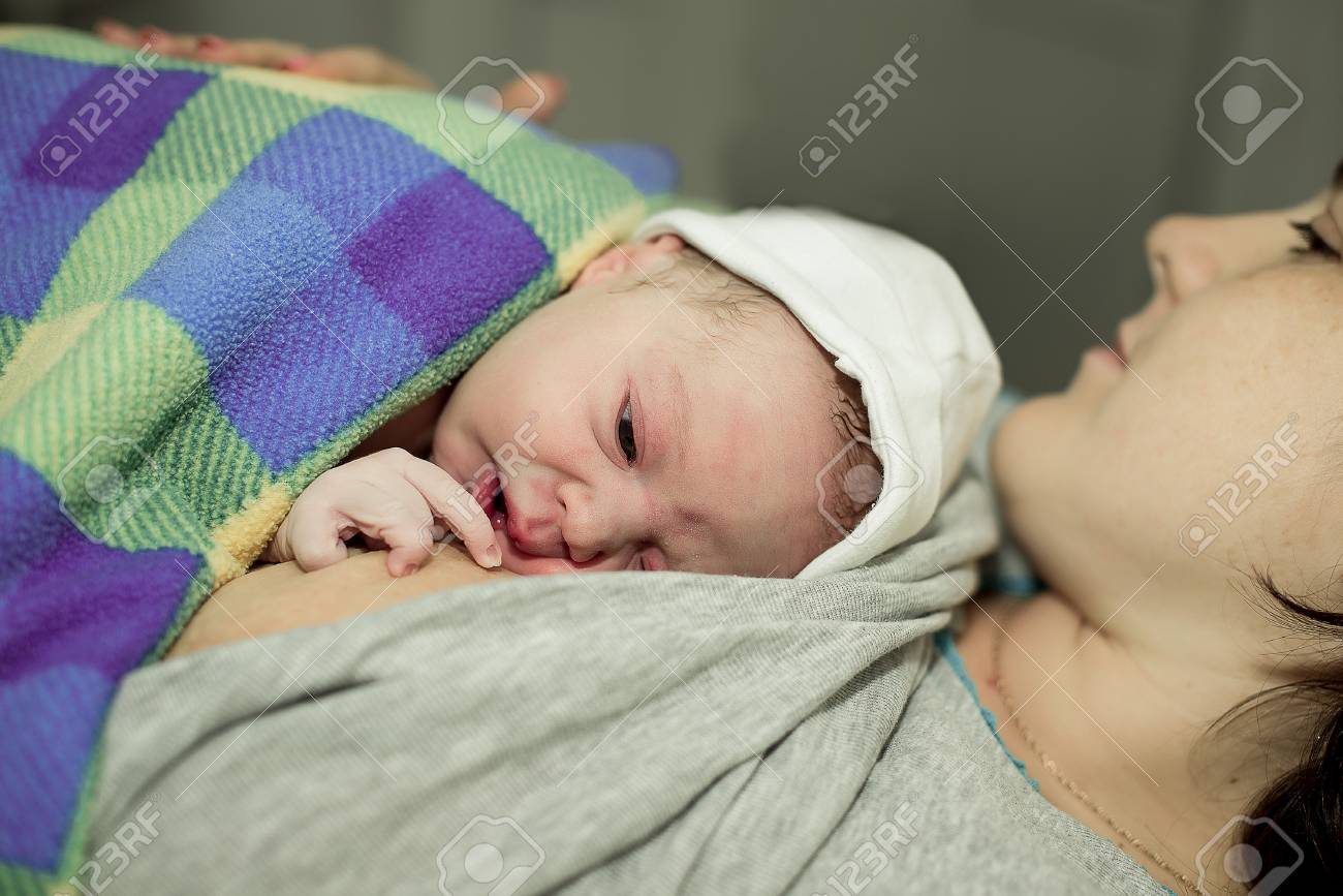 happy woman after the birth of a newborn baby on a functional bed - 37241715
