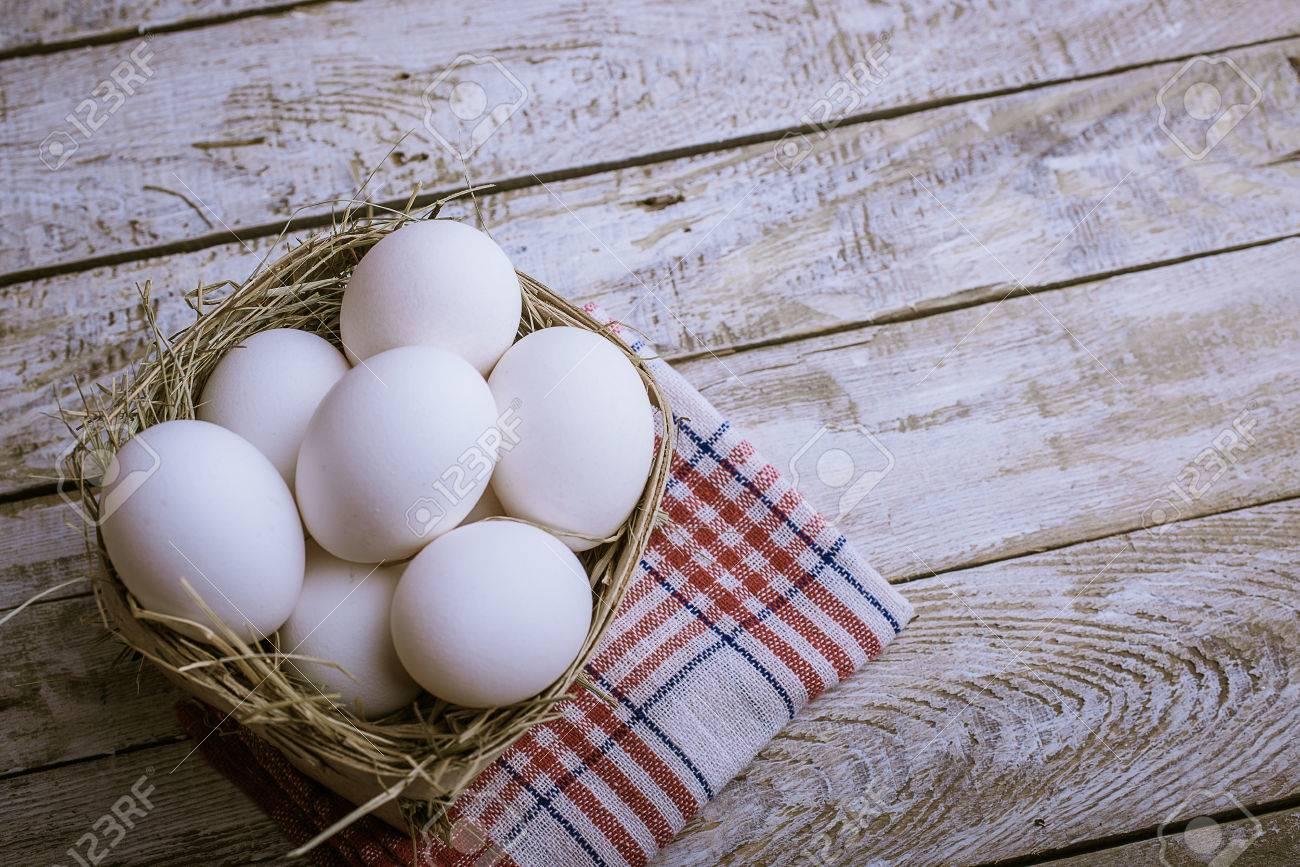 Chicken eggs in the basket. - 38705840