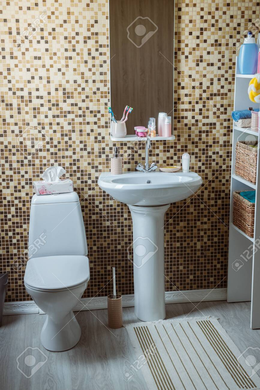 bathroom with toilet and sink - 133387010