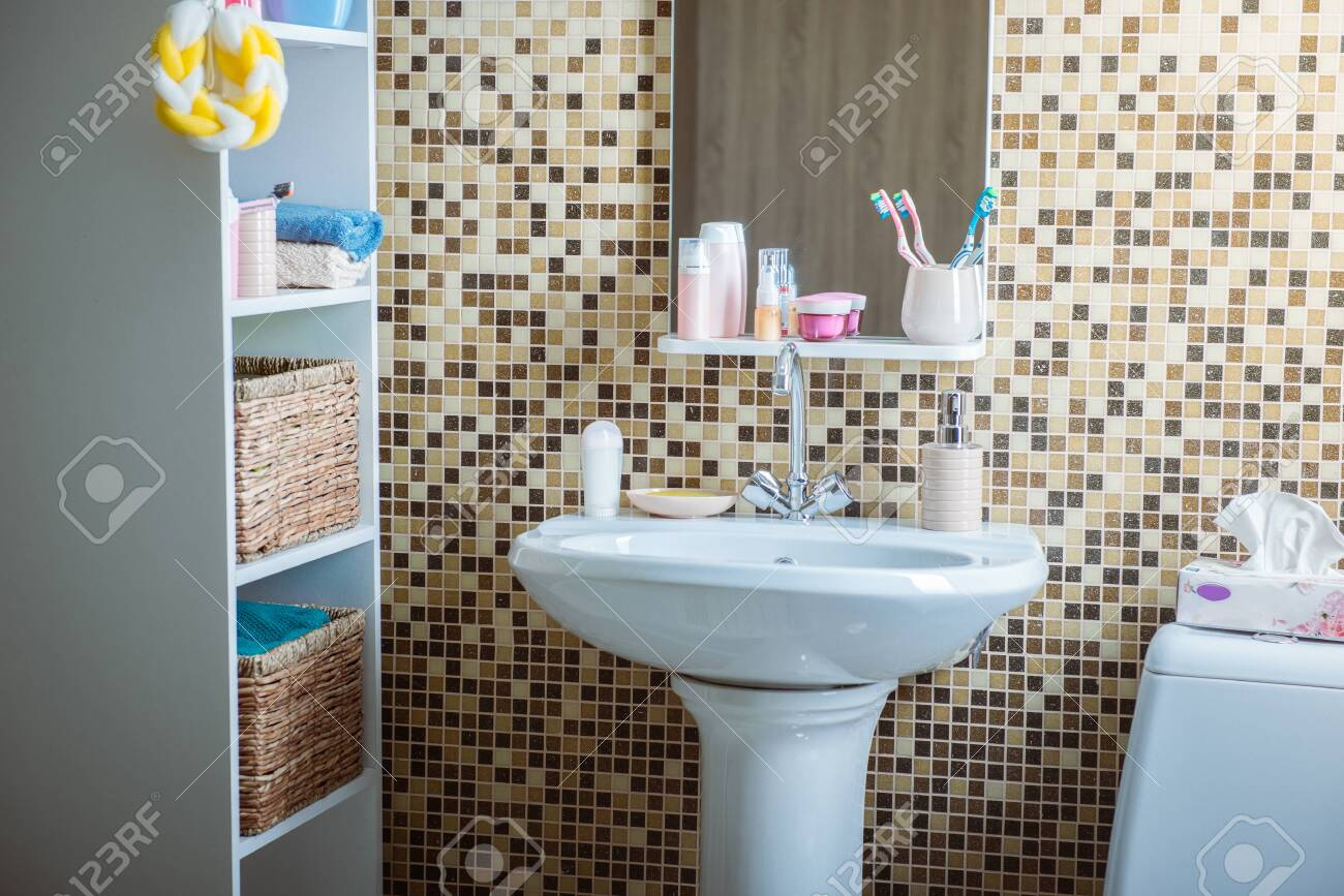 bathroom with toilet and sink - 133387011
