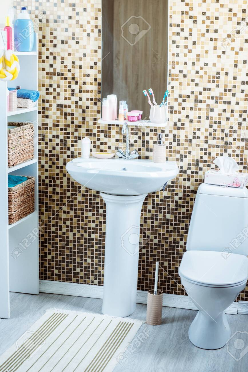 bathroom with toilet and sink - 133387016