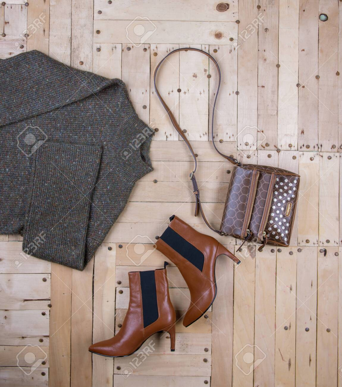 Women's autumn outfit on wooden background - 133252665