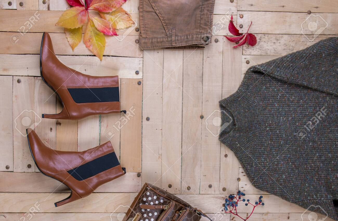 women's autumn clothes, Women's autumn outfit on wooden background - 133250285