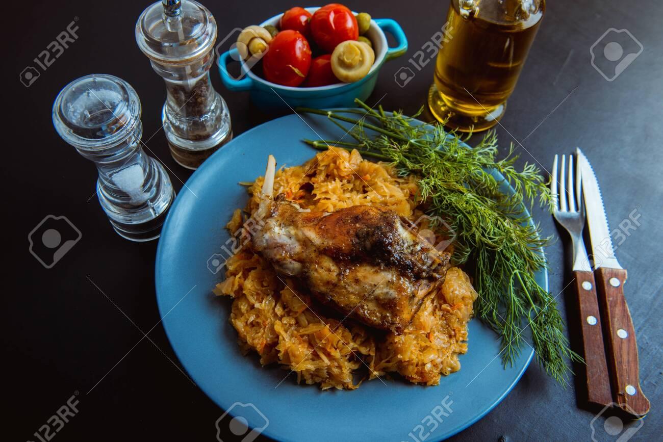 sauerkraut stew with fried meat, fried rabbit - 136253642