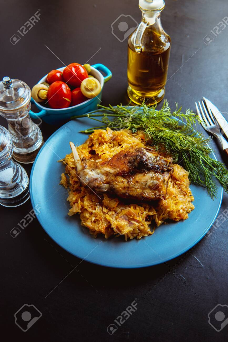 sauerkraut stew with fried meat, fried rabbit - 136253643