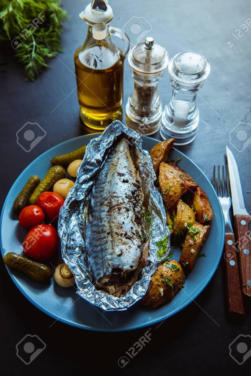baked mackerel in foil in the oven - 136325087
