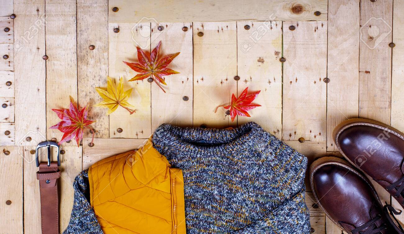 Stylish winter men's clothing on a wooden background. Branded quality wear. - 135119011