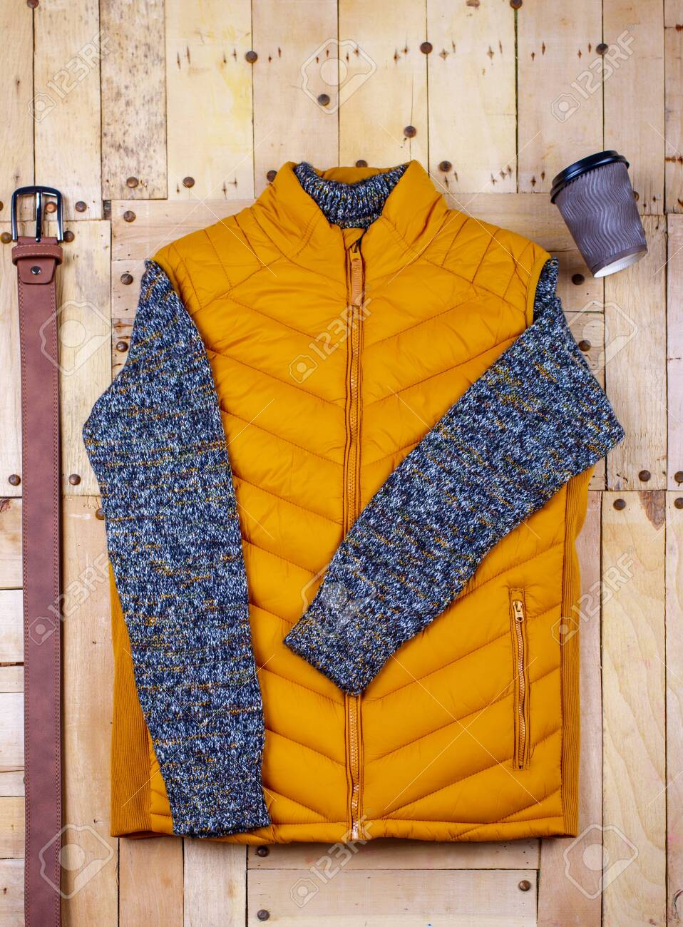 Winter men's clothes and accessories on a wooden background. - 136325110