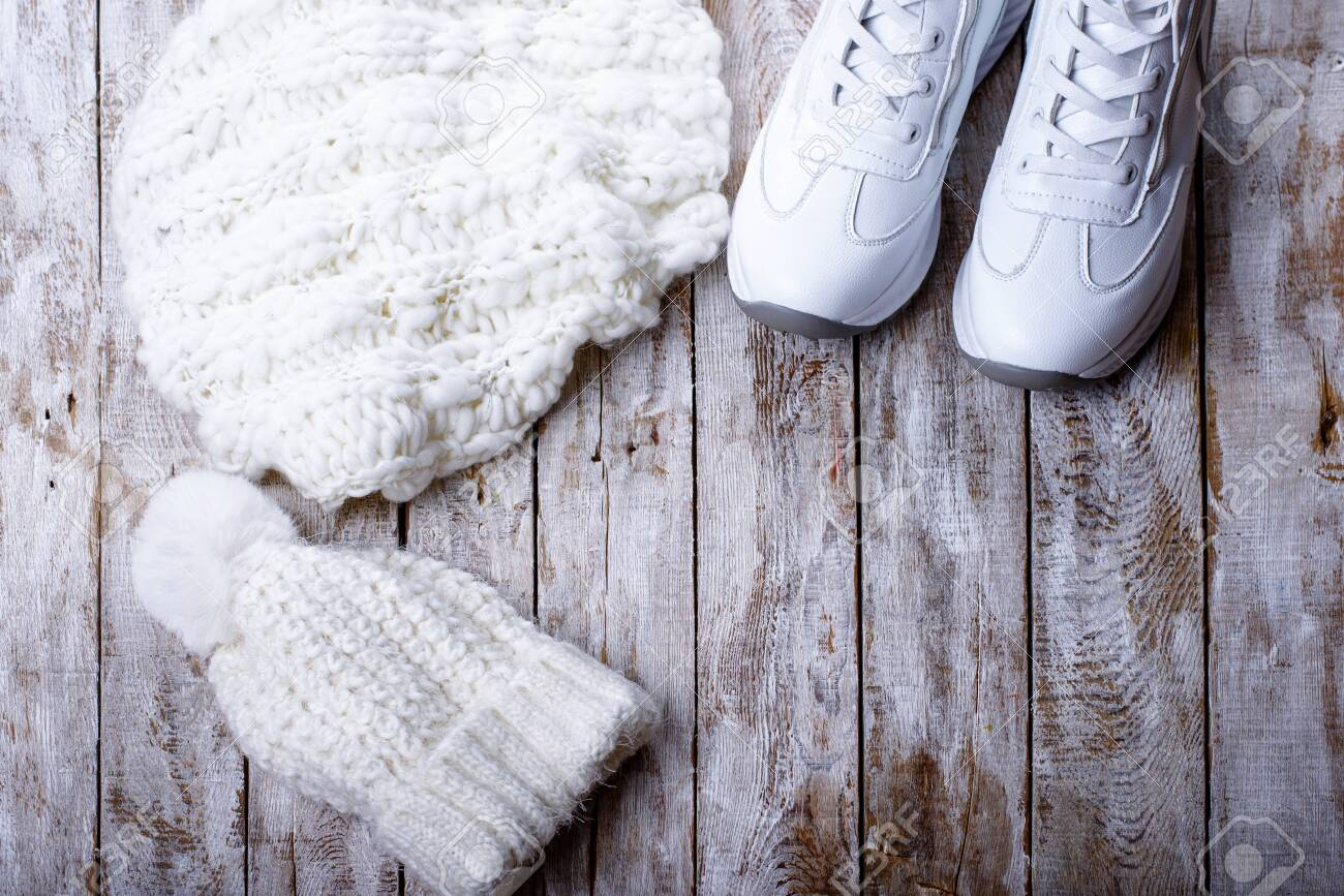 white winter clothes for women on wooden background - 135119004