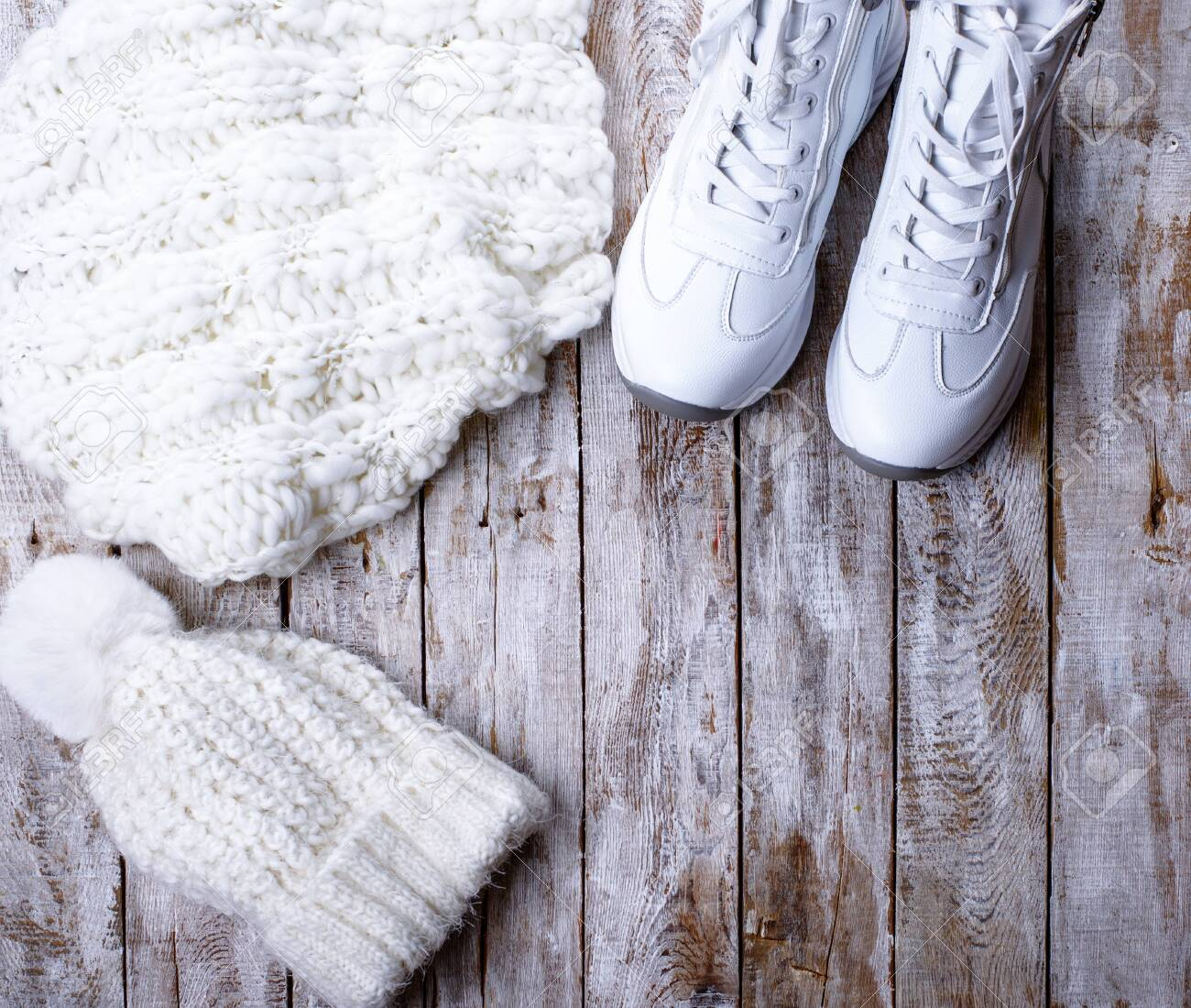 white winter clothes for women on wooden background - 135119034