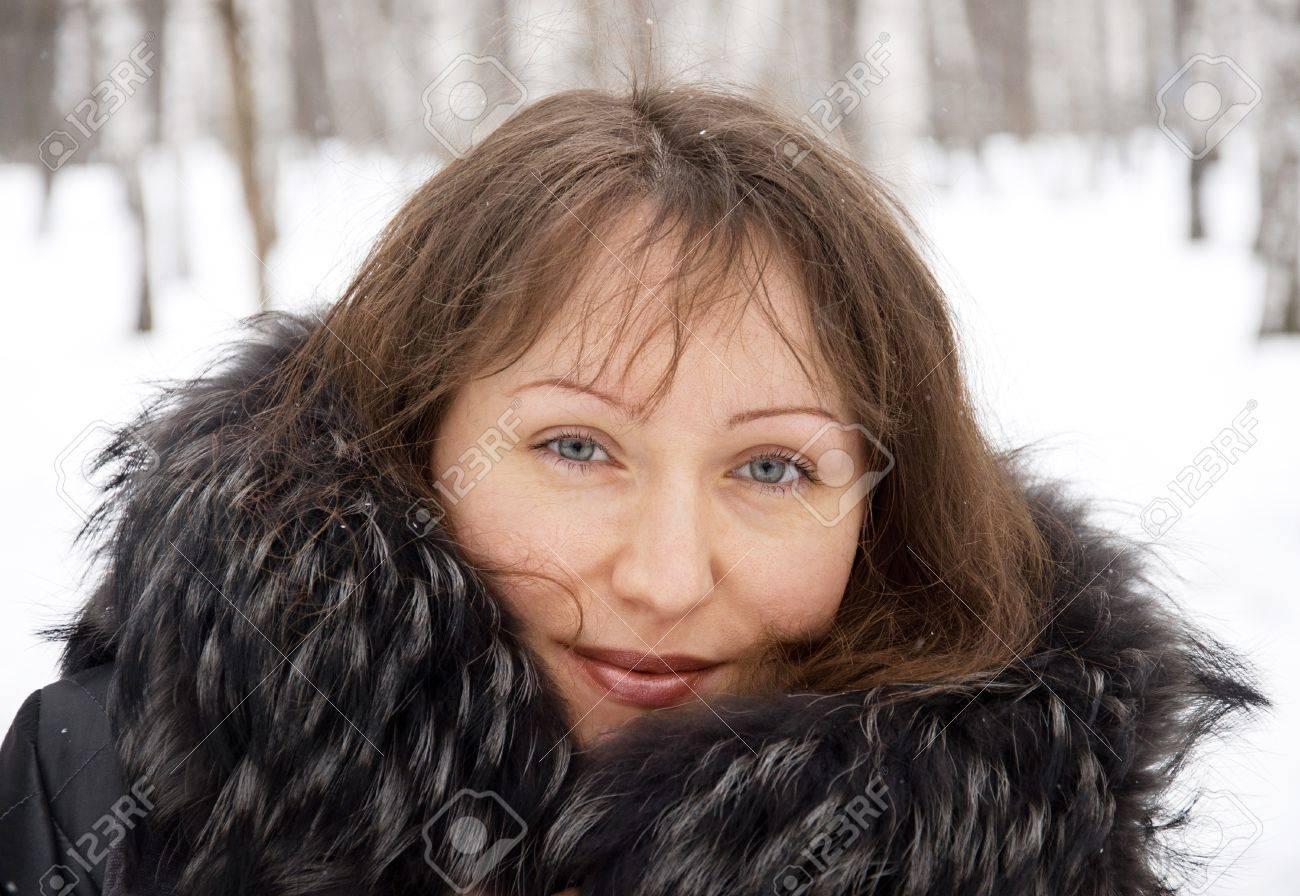 Portrait of beautiful brunette woman in snow winter park Stock Photo - 12667129