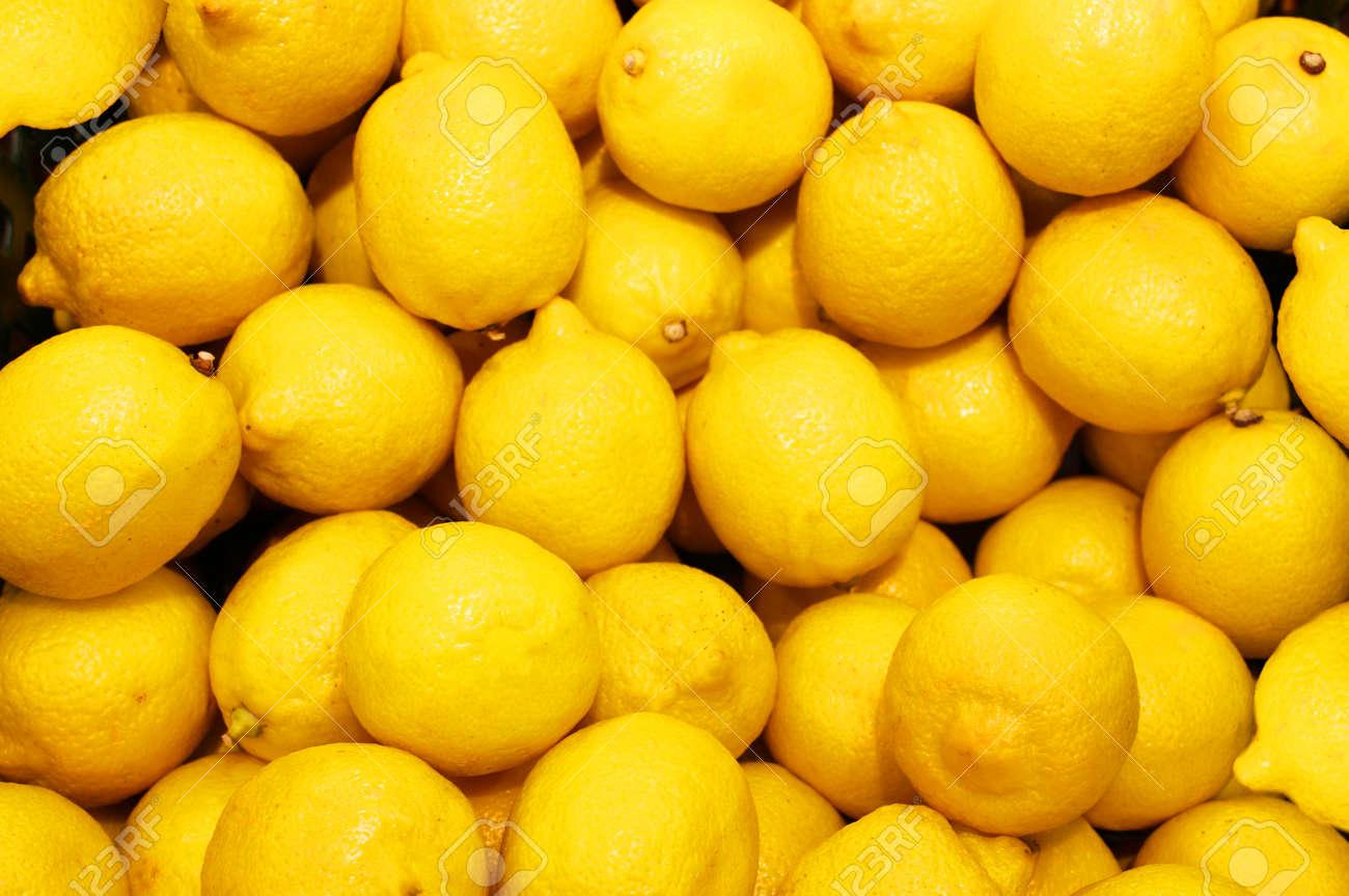 Lemon, orange, fresh fruit mix as background, top view. fresh citrus fruit market. A pile of oranges sitting on top of a wooden table - 158827360