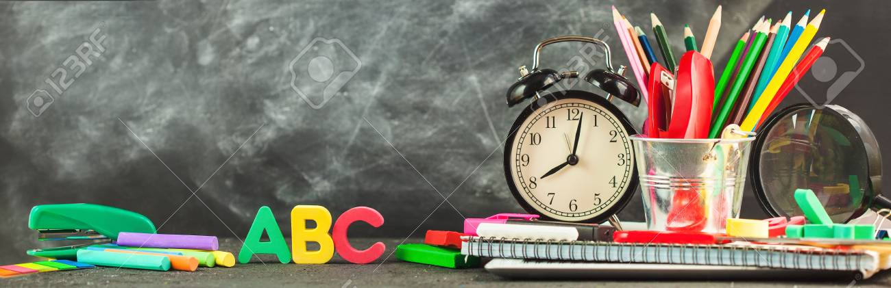 Banner Back to school Accessories for school on a dark background Pencils Plasticine letters Letters Alarm clock Chalk Copy space. - 105198689
