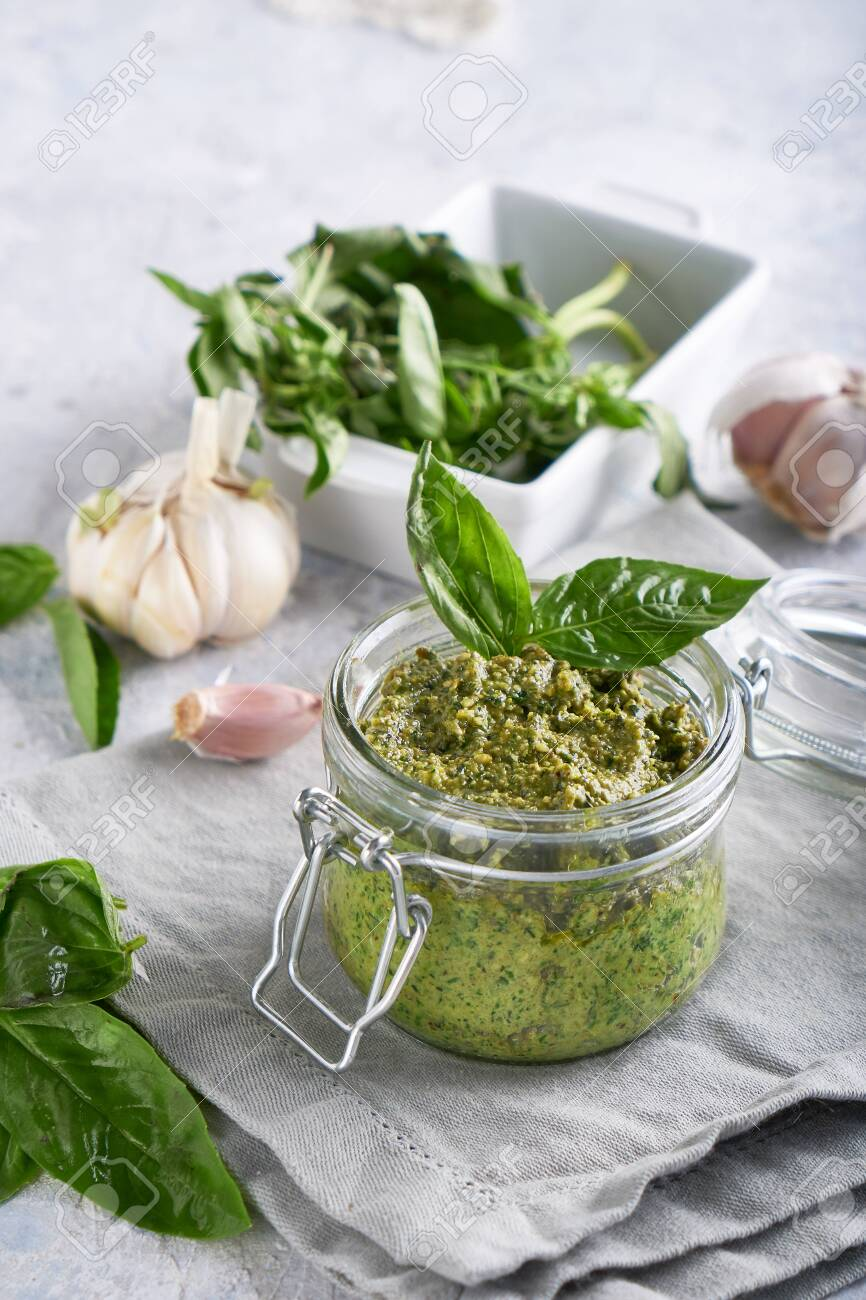 Traditional Italian Basil Pesto Sauce In A Glass Jar On A Light Stock Photo Picture And Royalty Free Image Image 132407970