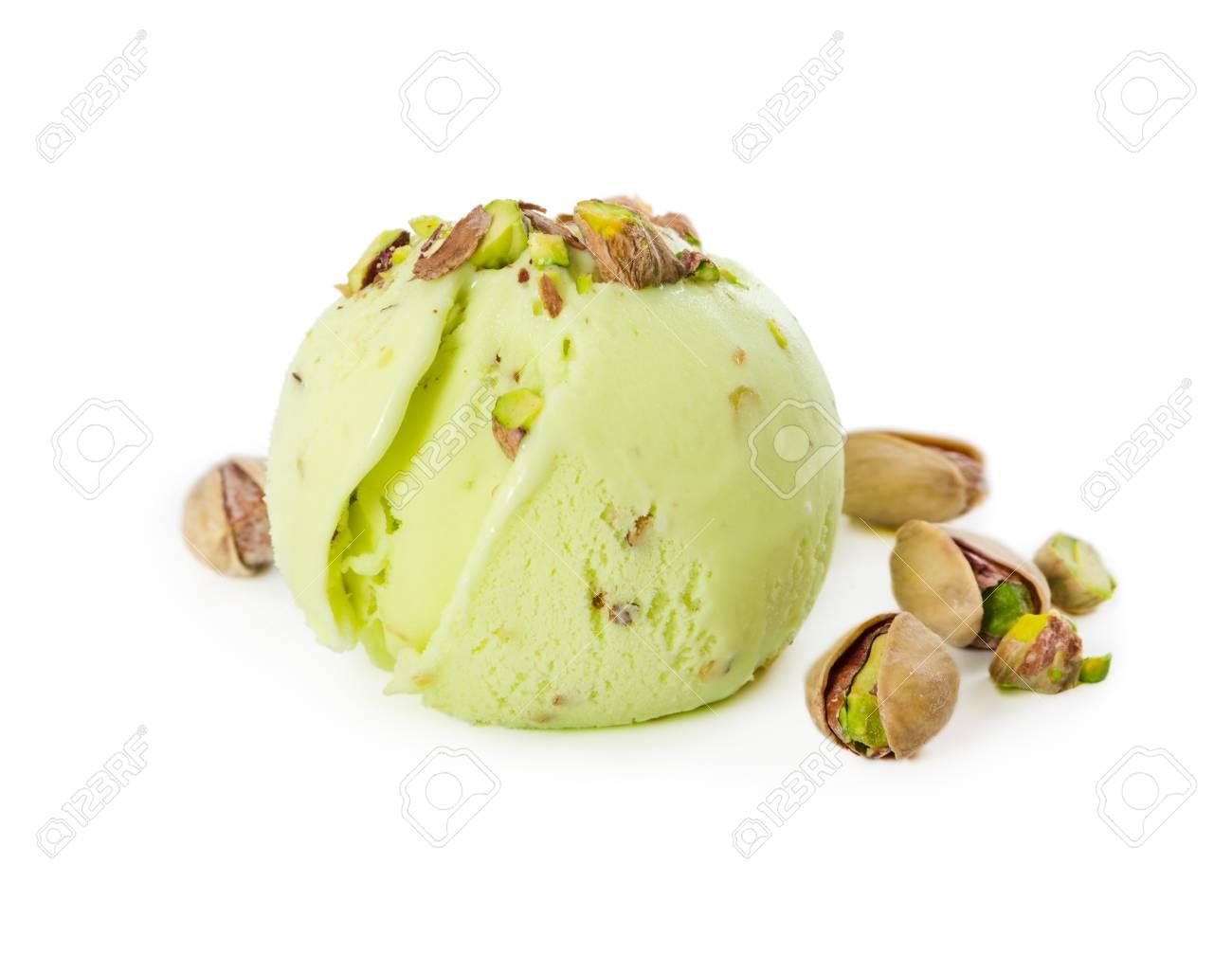 Scoop of pistachio ice cream with pistachios isolated on white background - 102523654