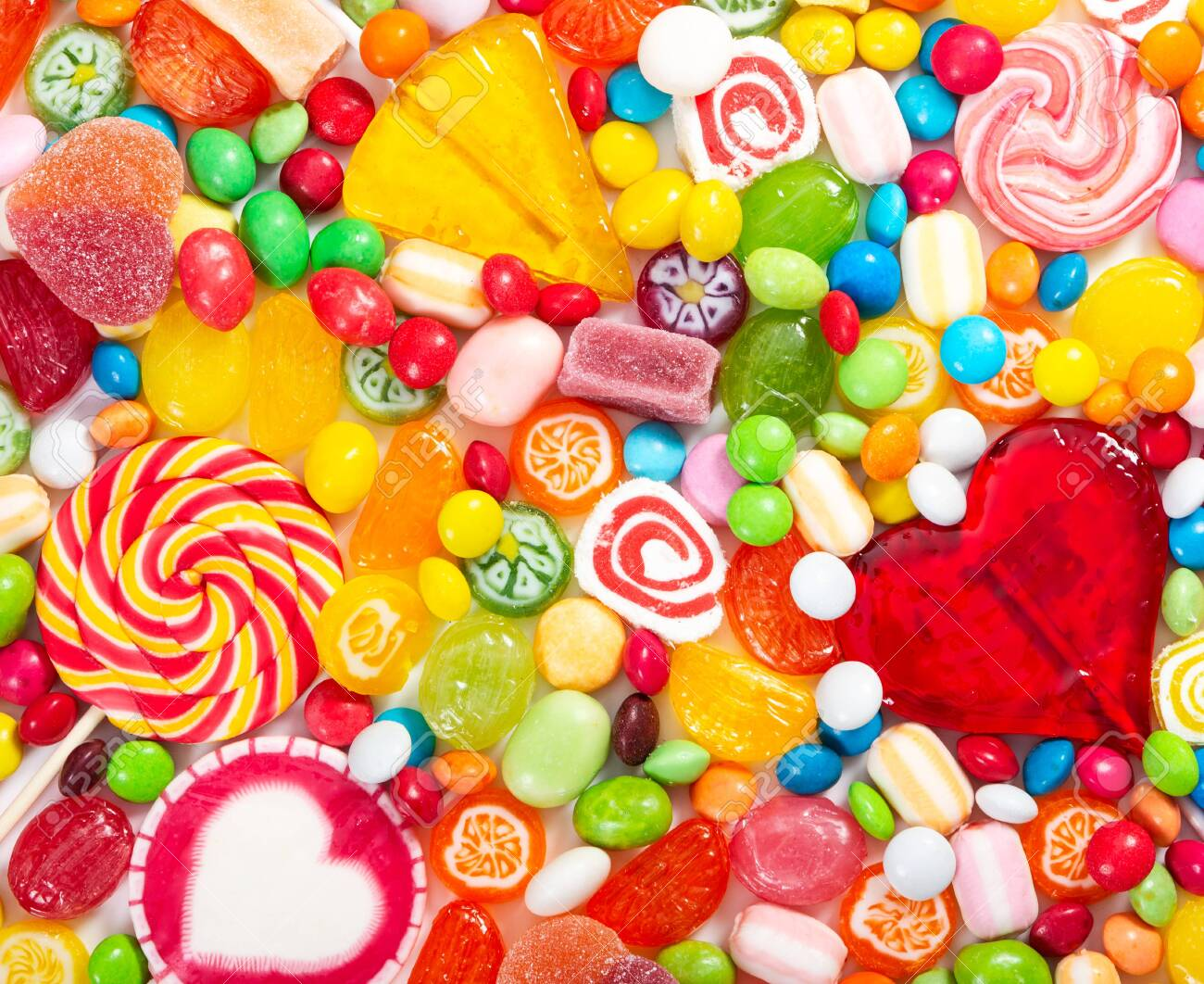 Colorful lollipops and different colored round candy. Top view. - 131872887