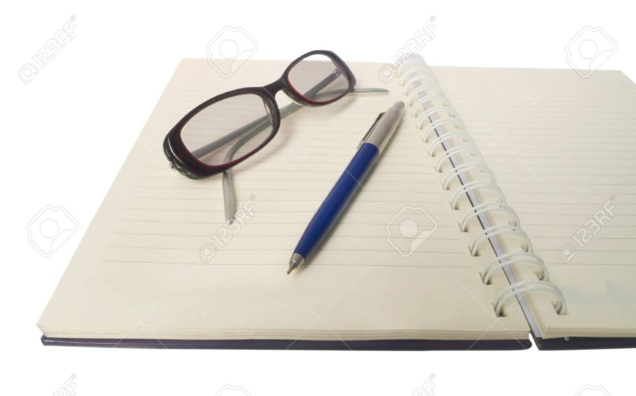 Notebook with glasses isolated on white Stock Photo - 18554036