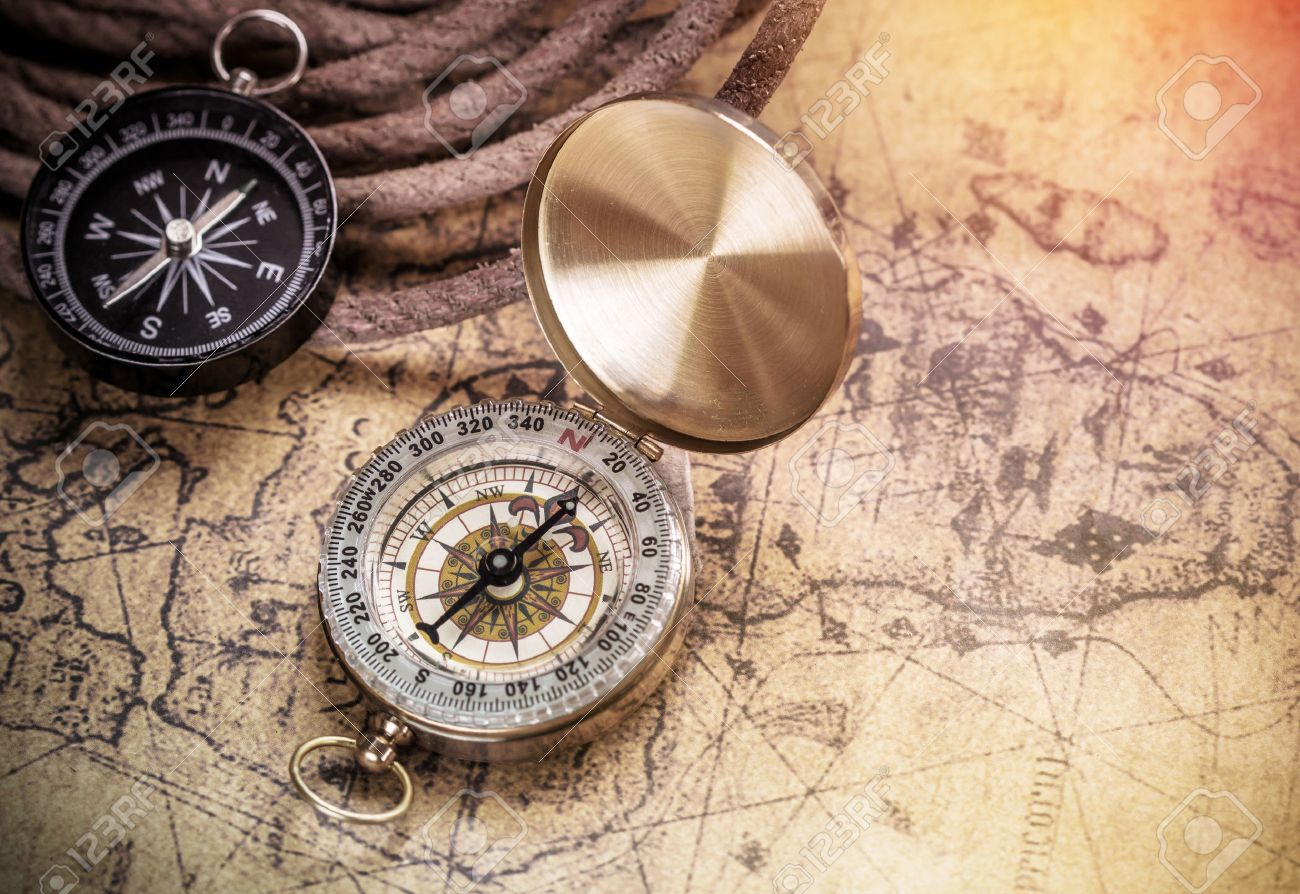 compass on vintage map with accessory to the Adventure. - 43213153