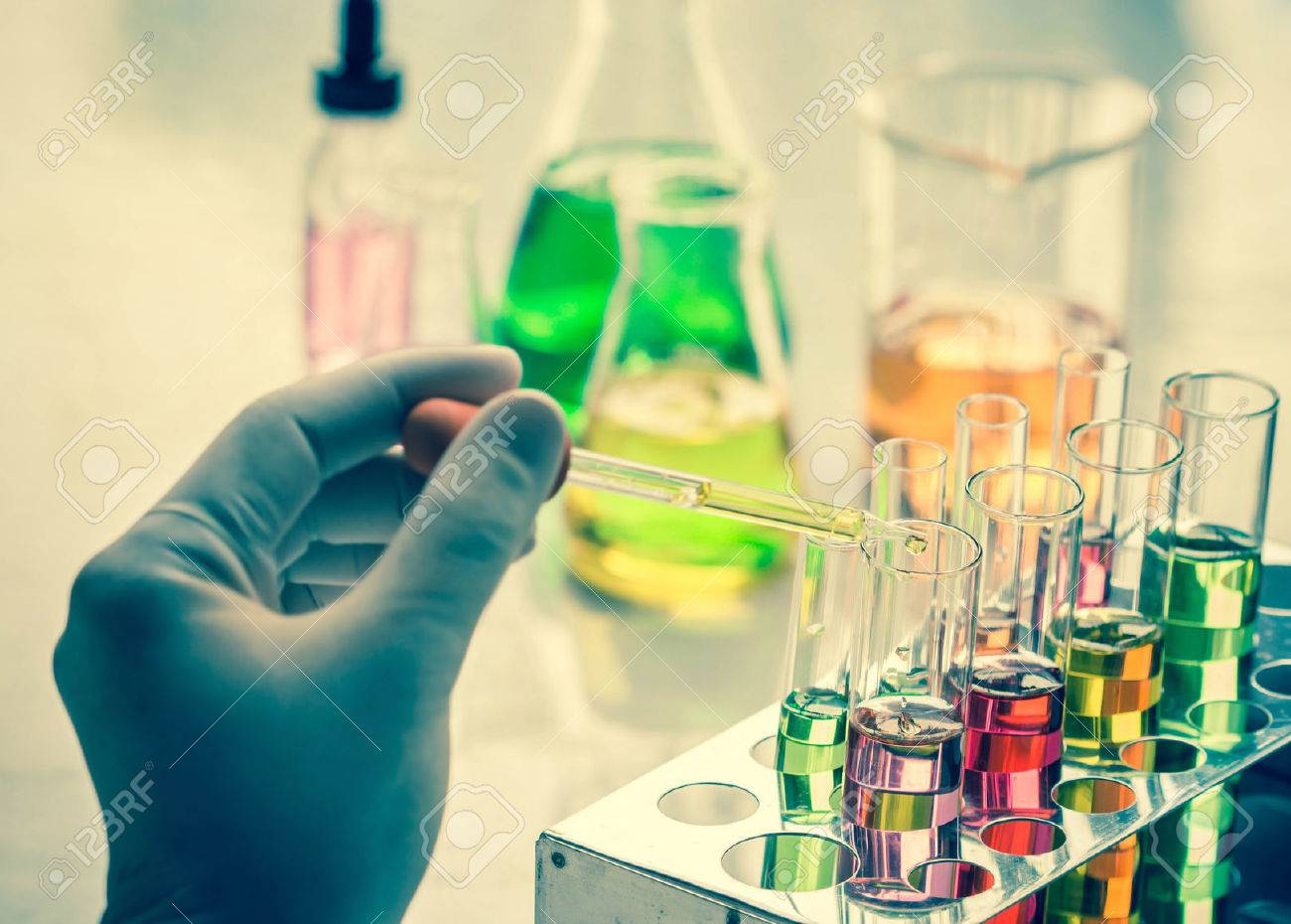 Scientist hand holding a Test tubes,Laboratory research. - 47257706