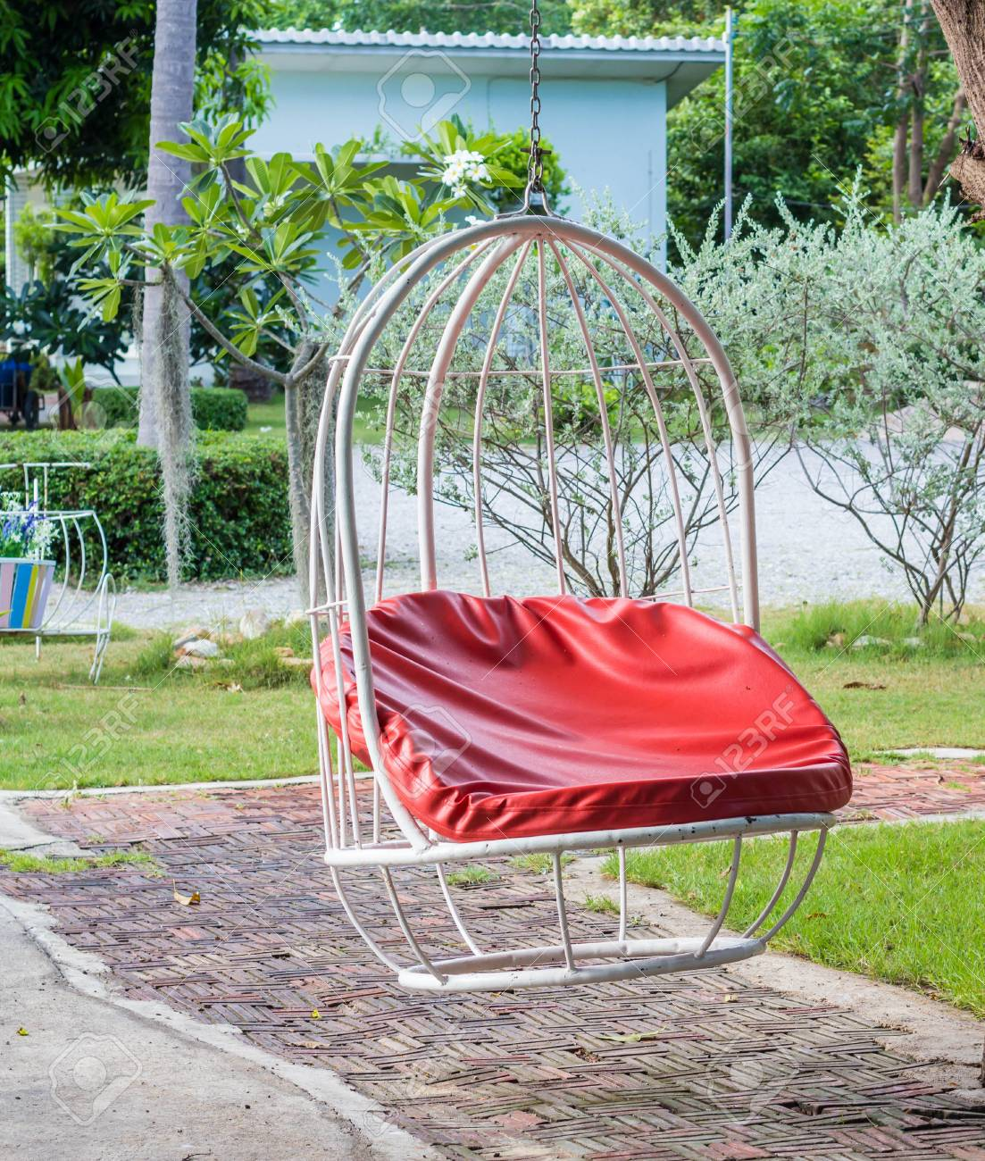 Stock Photo   Vintage Hanging Chair In The Garden.