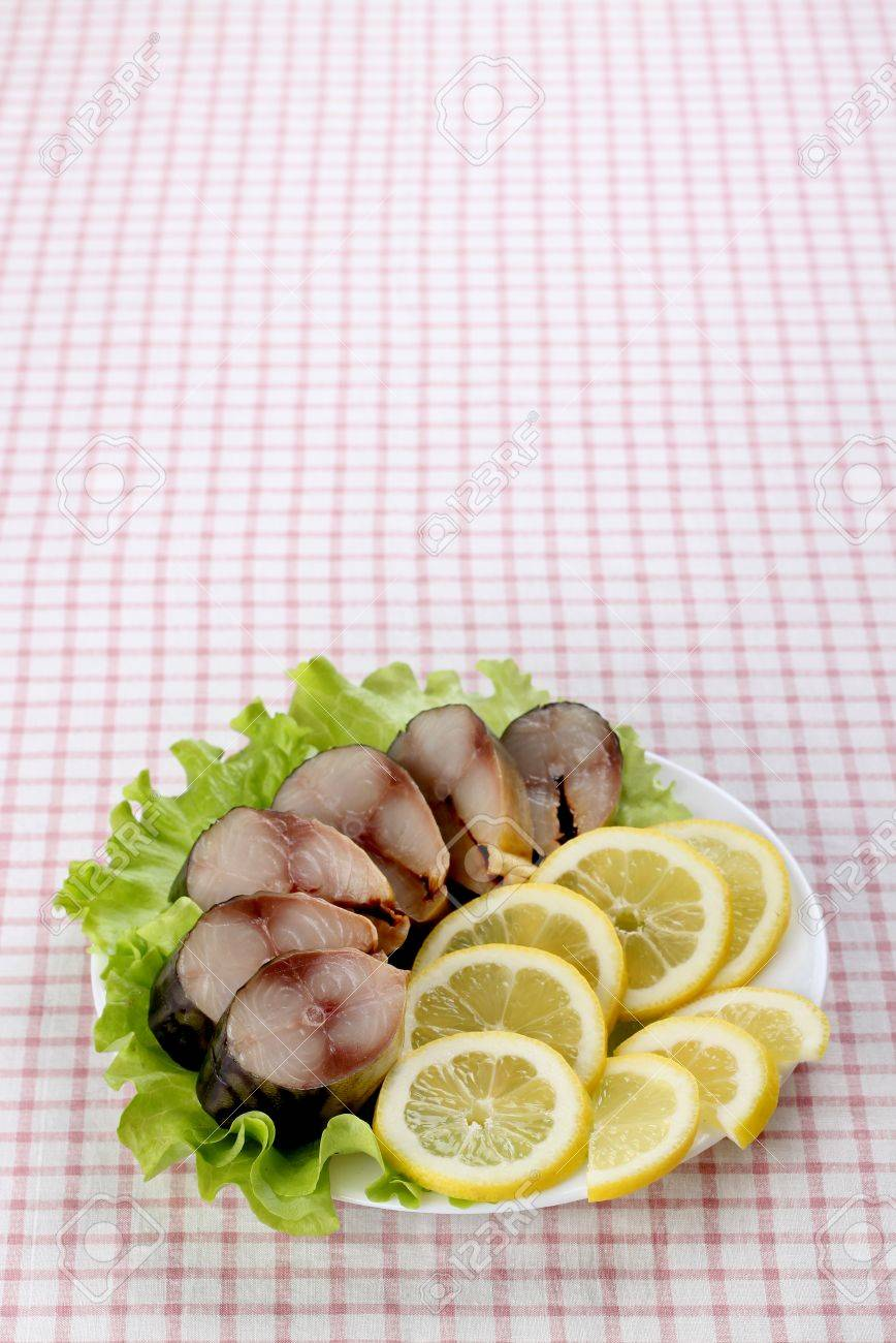 Composition with Smocked Mackerel Fish, Lemon and Salad Leaves on Wooden Table with Tablecloth. Stock Photo - 17702656