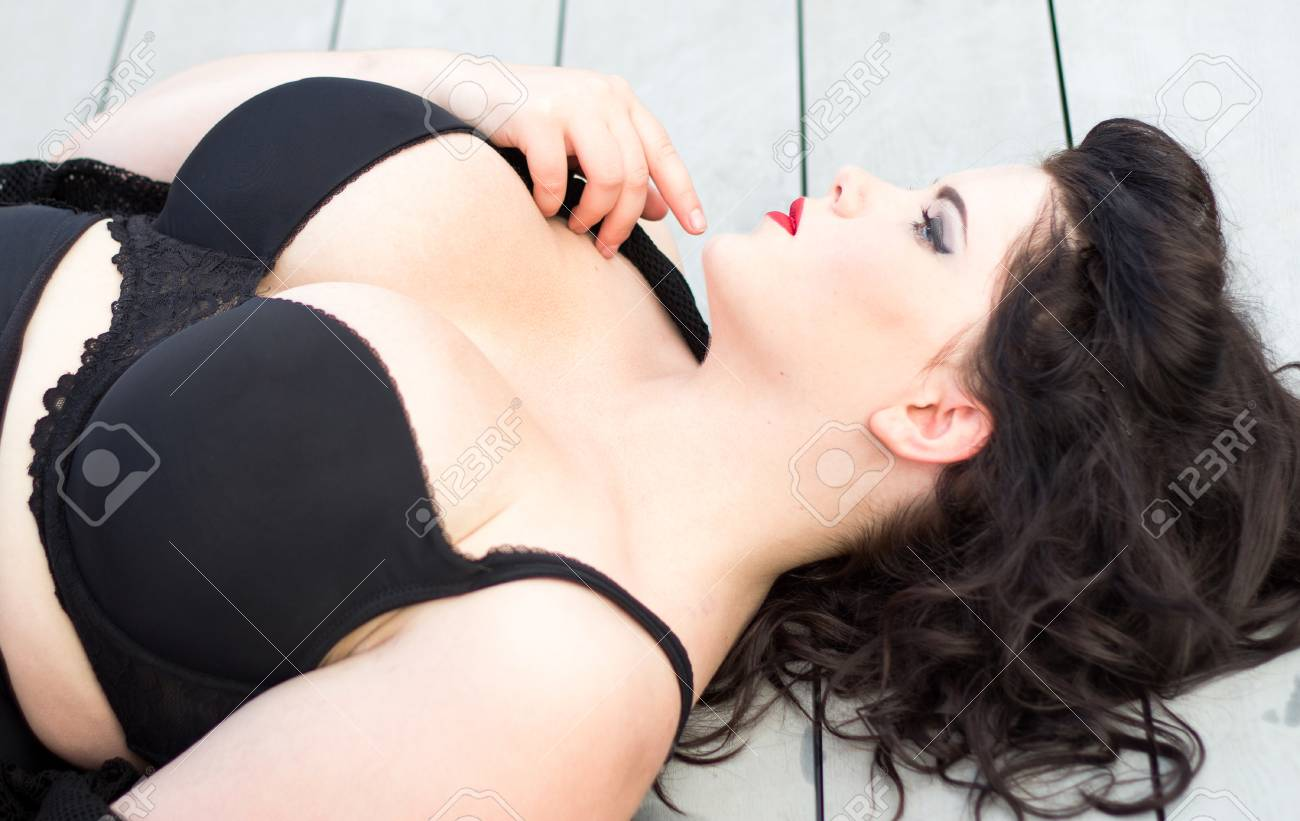 195d755c967 Stock Photo - Young beautiful plus size model with big breast in black bra