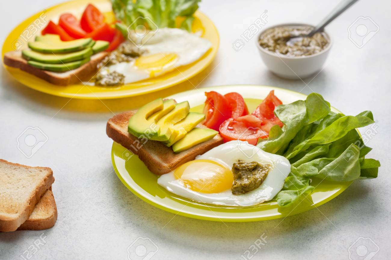 Healthy Diet Breakfast Toast With Slices Of Avocado Fried Egg Tomatoes Watercress