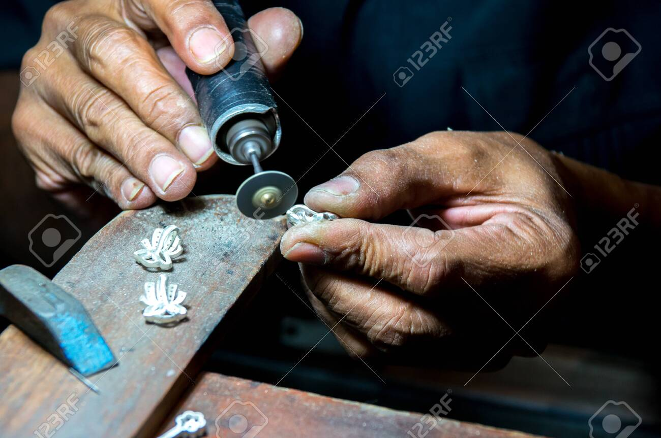 Close-up of making earrings by polishing a motor tool in a workshop - 140991891