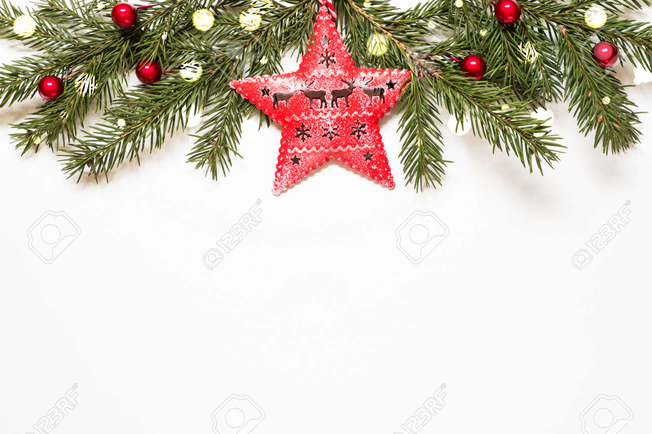 Composition with christmas tree branches, star and christmas lights on white background. - 158826963