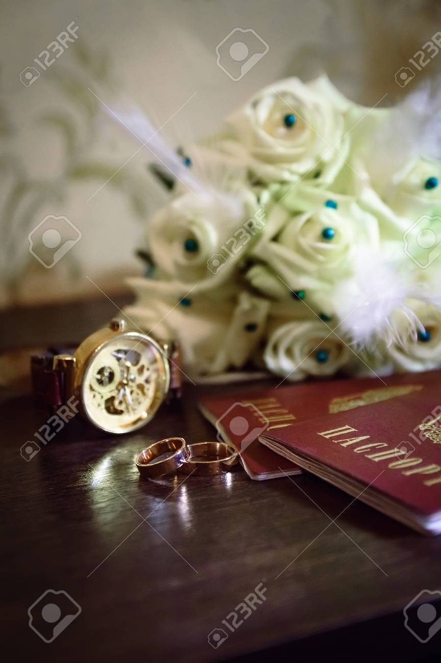 Wedding Rings Watches Documents And White Bouquet Stock Photo