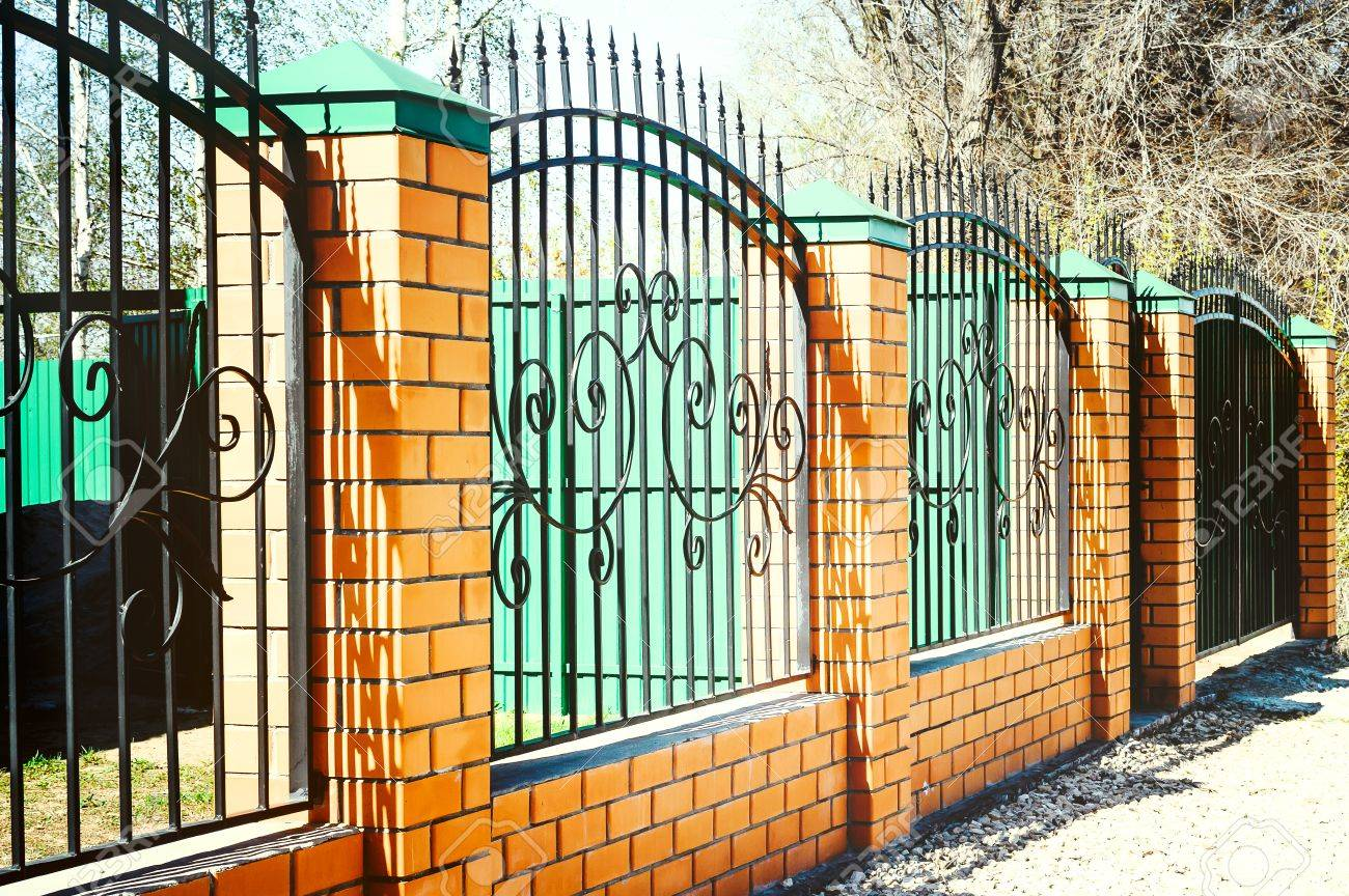 metal fence ideas. Perfect Ideas Brick And Metal Fence With Door Gate Of Modern Style Design  Ideas Throughout Ideas