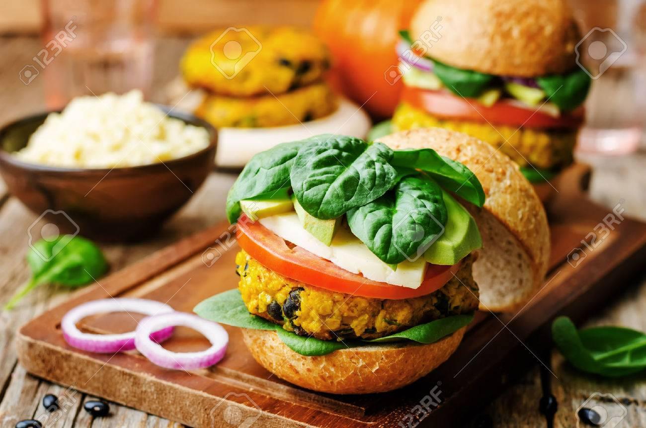 vegan millet black bean pumpkin burgers on a dark wood background - 42738928