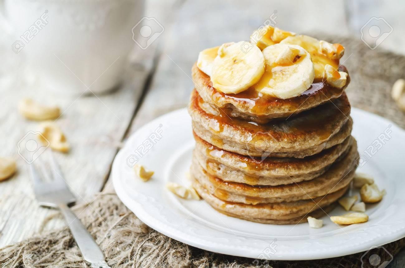banana cashew pancakes with bananas and salted caramel sauce. the toning. selective focus - 44421470