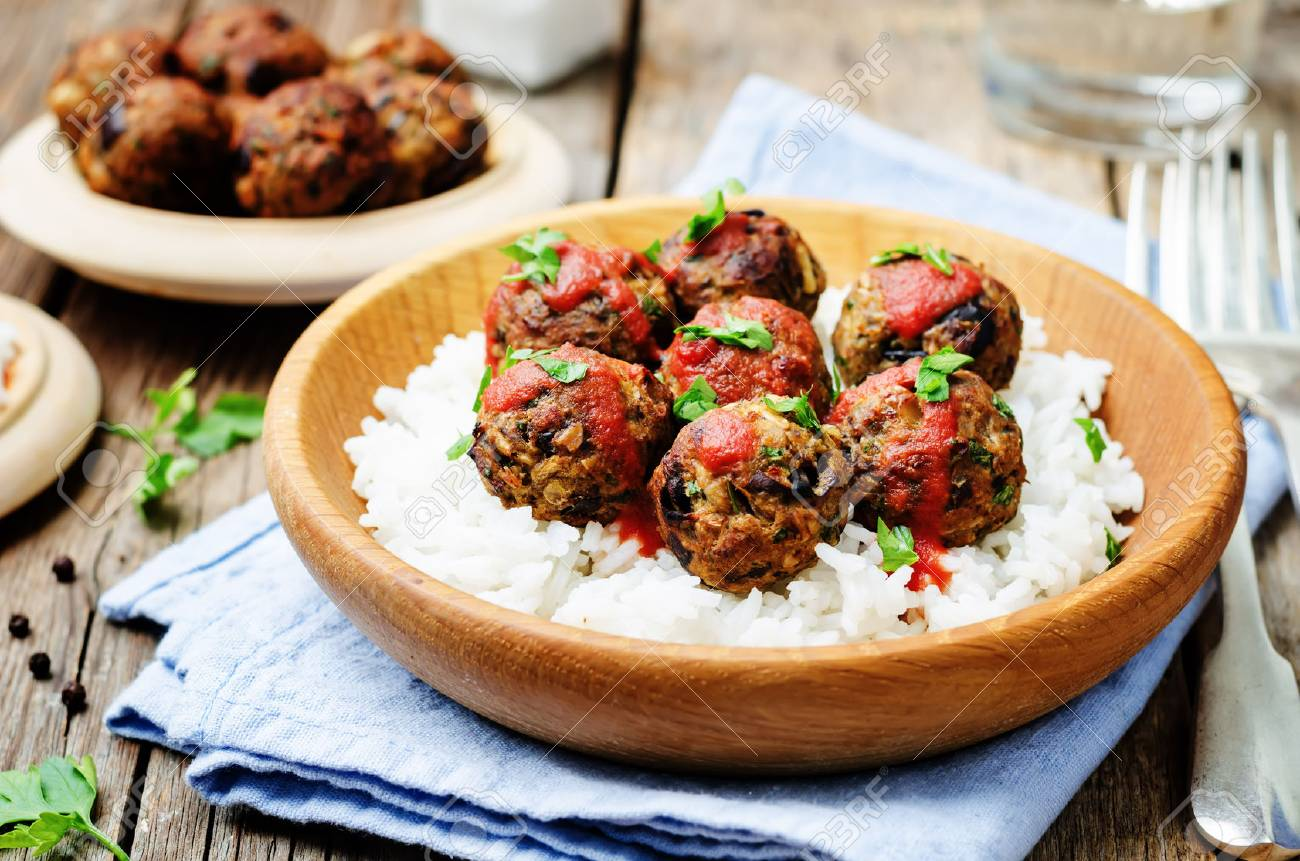 Eggplant white beans vegan meatballs with tomato sauce and rice. toning. selective focus - 55671226