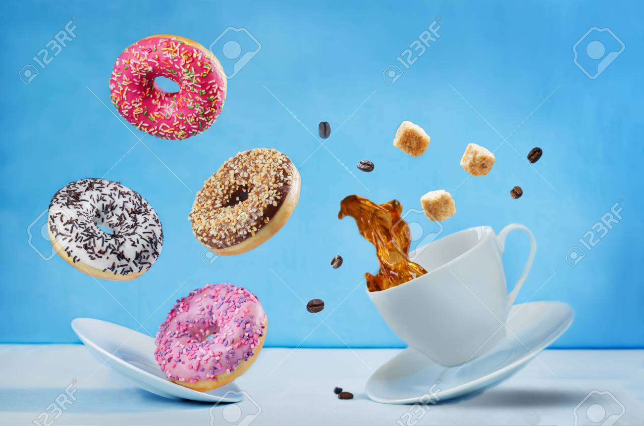 Flying cup of coffee with multicolored donuts - 111011485