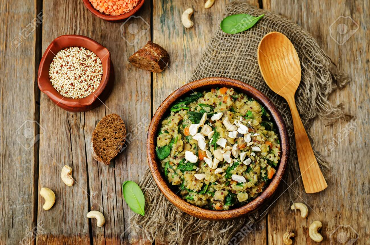 lentils mushroom spinach quinoa with fresh spinach leaves and cashews. toning. selective Focus - 141102464