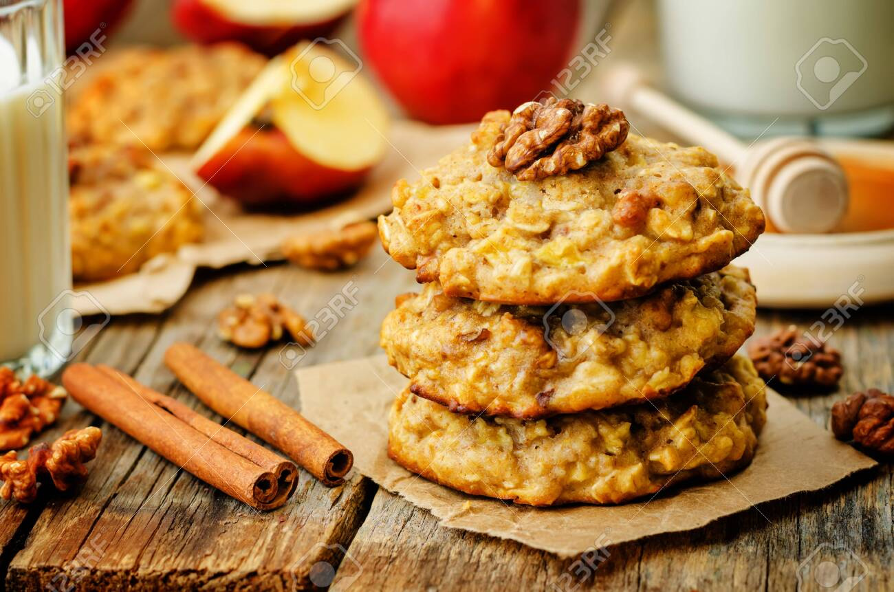 apples oats cinnamon cookies on a wood background. the toning. selective focus - 145240289