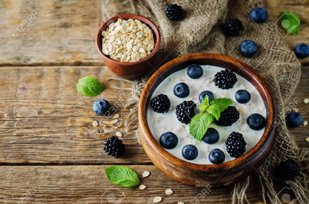 Oatmeal porridge with fresh blueberries and blackberries. toning. selective focus - 149274564