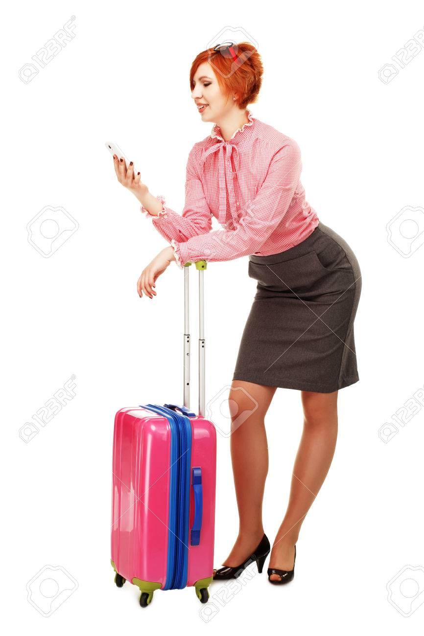 de7bd4af35b Banque d images - Femme d affaires en voyage d affaires avec un Chariot à  bagages Sac Valise parlant mobile et souriant