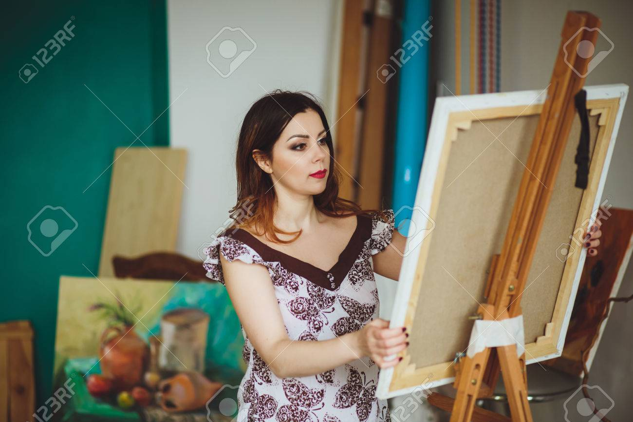 Woman Artist Painting A Picture In A Studio Creative Pensive