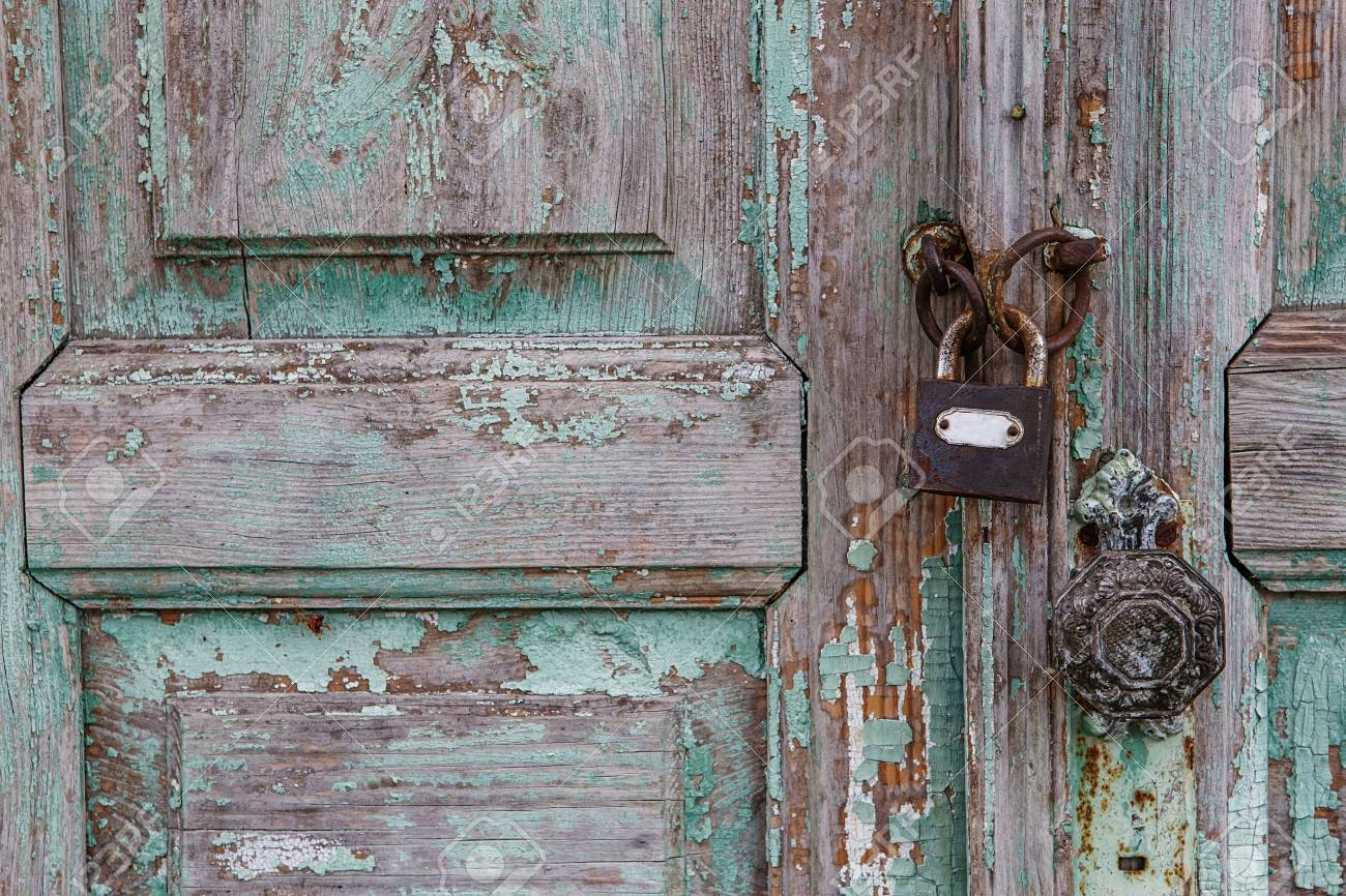 Rusty Lock On Old Door. Cracking And Peeling Paint On A Wall. Vintage Wood