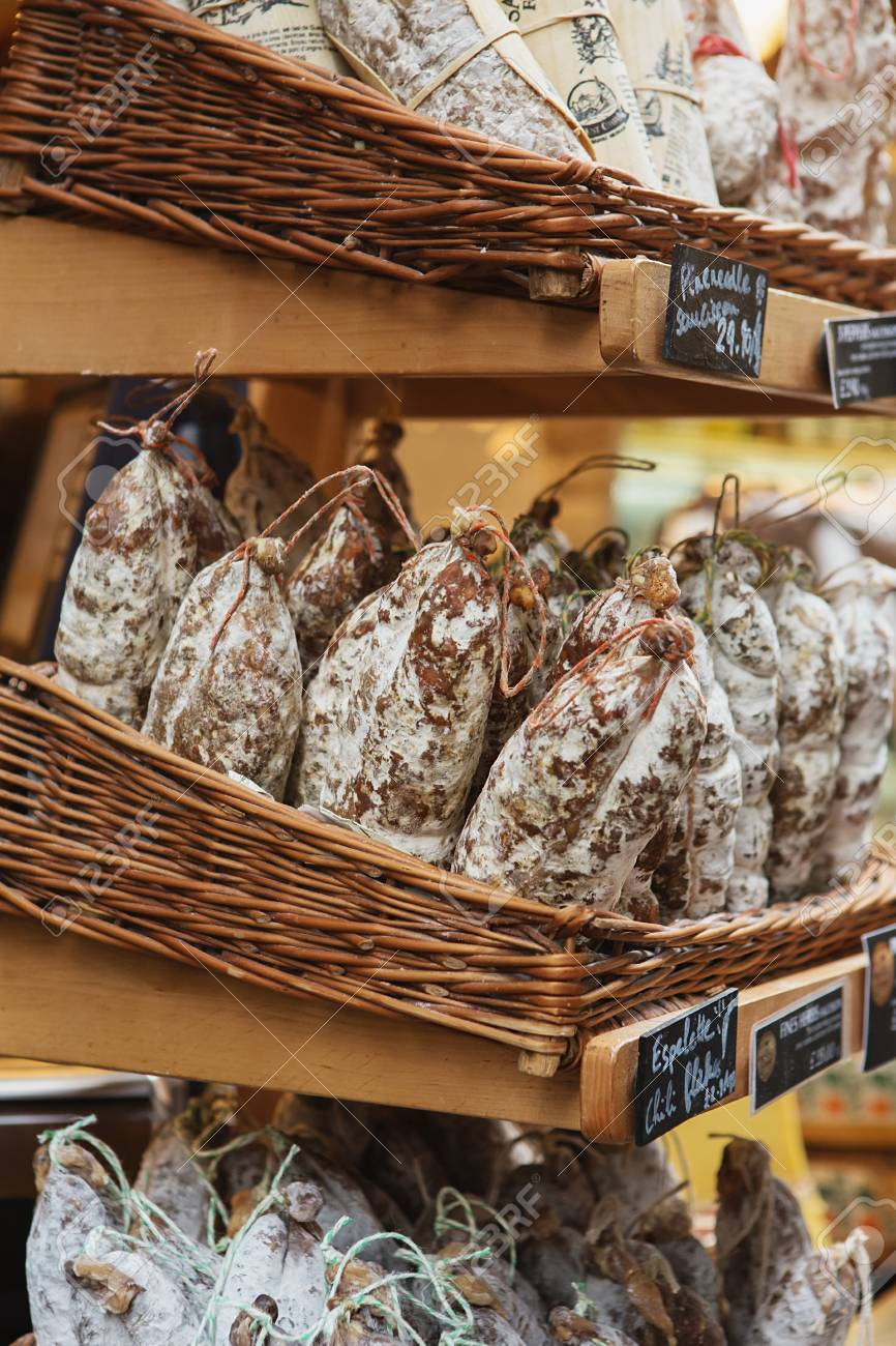 Saucissons on Borough market in London. Saucissons is large thick French sausages, typically form in texture and flavored with herbs. - 86345087