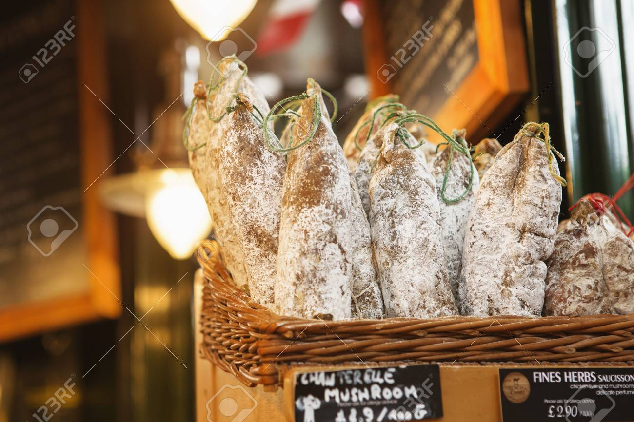 LONDON - AUGUST 23, 2017: Saucissons on Borough market in London. Saucissons is large thick French sausages, typically form in texture and flavored with herbs. - 86345095