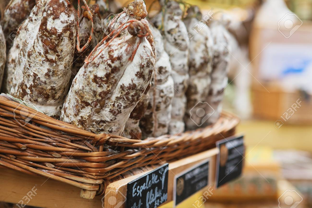 Saucissons on Borough market in London. Saucissons is large thick French sausages, typically form in texture and flavored with herbs. - 86345114