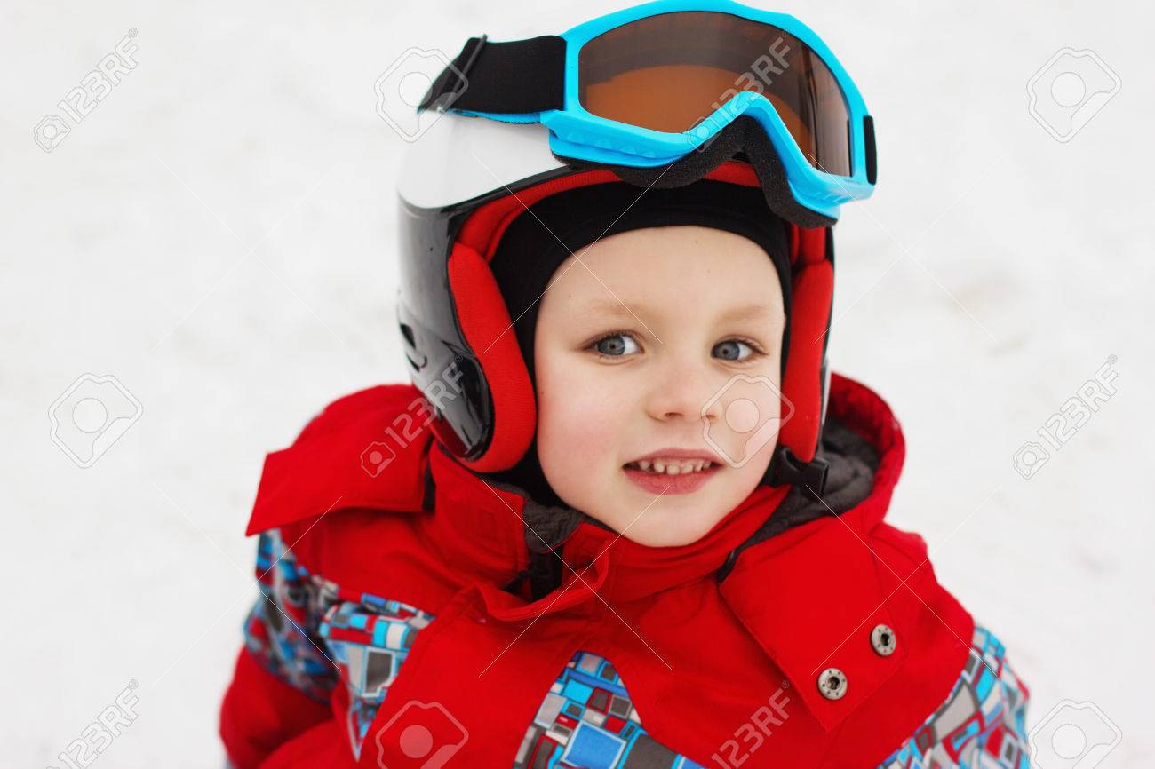 51ee6d0284d4 Little cute boy with skis and a ski outfit. Little skier in the..