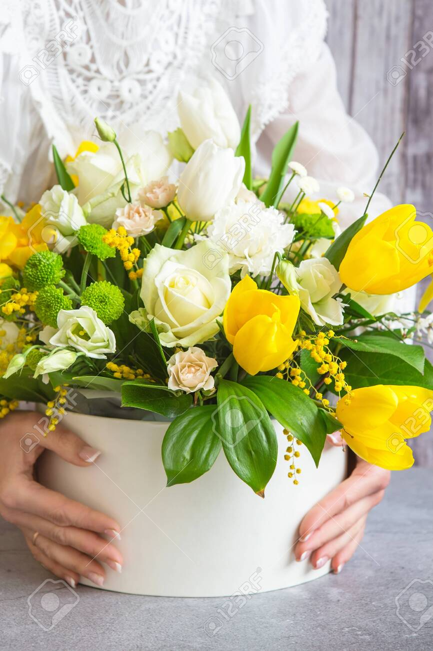 Bouquet Of Beautiful Flowers With White Peonies Roses Eustomas And Yellow Tulips Mimosa With Green Leaves In The Papper Gift Box Spring Medley Bouquet Girl Holding Flowers Stock Photo Picture And Royalty