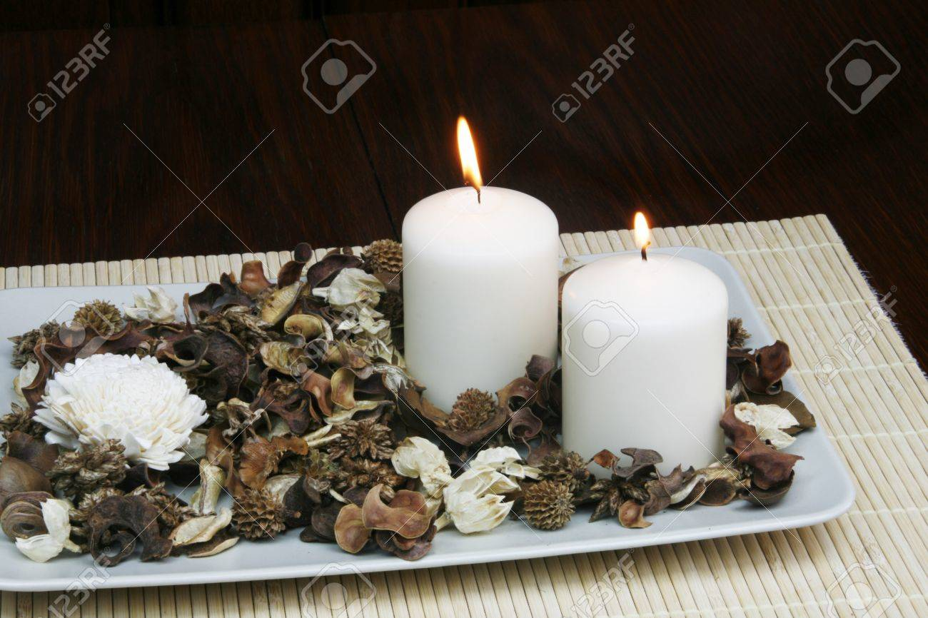 Decorative Plate With Dried Flowers And Burning Candle