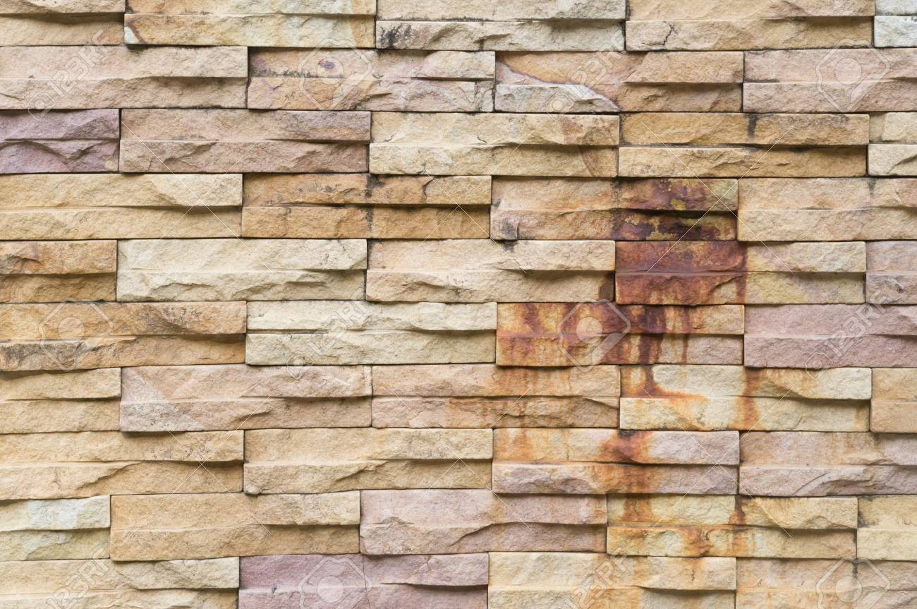 Rust - burned yellow stone wall background in horizontal pattern