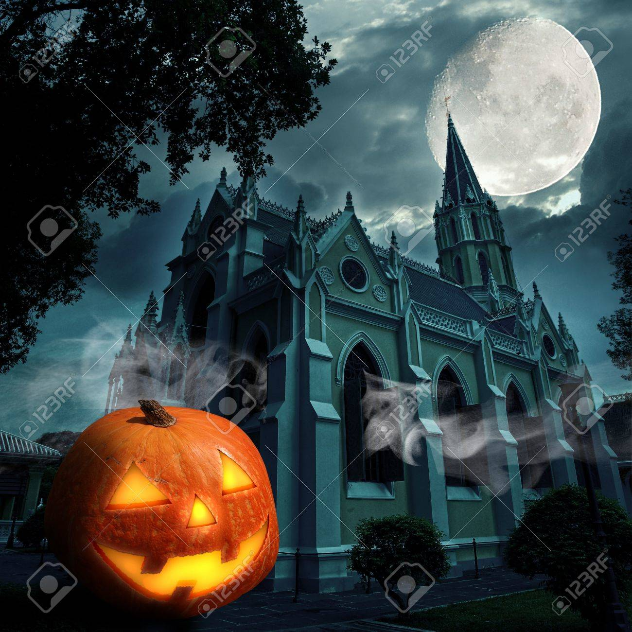 scary halloween pumpkin jack o lantern candle lit at church stock photo 10798211