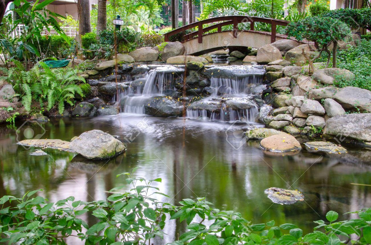 Stock Photo   Waterfall In The Gaden